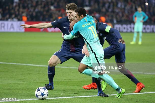 Neymar Jr of FC Barcelona and Thomas Meunier of PSG in action during the UEFA Champions League Round of 16 first leg match between Paris SaintGermain...