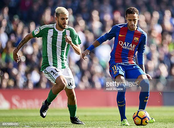 Neymar Jr of FC Barcelona being followed by Dani Ceballos of Real Betis Balompie during the La Liga match between Real Betis Balompie and FC...
