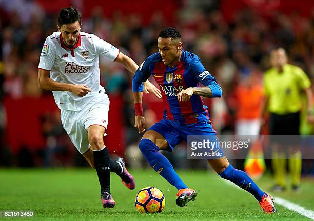 Neymar Jr of FC Barcelona being followed by Pablo Sarabia of Sevilla FC during the match between Sevilla FC vs FC Barcelona as part of La Liga at...
