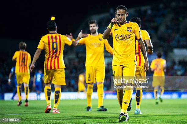 Neymar JR of FC Barcelona celebrates scoring their second goal with teammate during the La Liga match between Getafe CF and FC Barcelona at Coliseum...