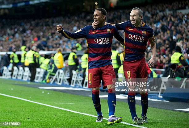 Neymar JR of FC Barcelona celebrates scoring their second goal with teammate Andres Iniesta during the La Liga match between Real Madrid CF and FC...