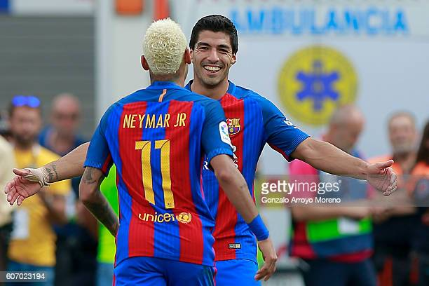 Neymar JR of FC Barcelona celebrates scoring their third goal with teammate Luis Suarez during the La Liga match between Deportivo Leganes and FC...