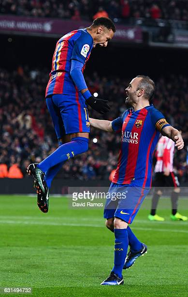 Neymar Jr of FC Barcelona celebrates with his team mate Andres Iniesta of FC Barcelona after scoring his team's second goal from the penalty spot...
