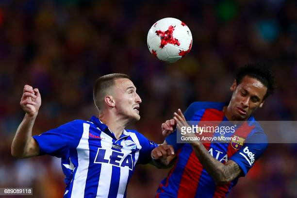 Neymar JR of FC Barcelona competes for the ball with Aleksandar Pantic of Deportivo Alaves during the Copa Del Rey Final between FC Barcelona and...