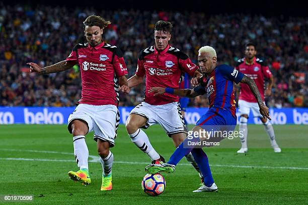 Neymar Jr of FC Barcelona competes for the ball with Deportivo Alaves players during the La Liga match between FC Barcelona and Deportivo Alaves at...