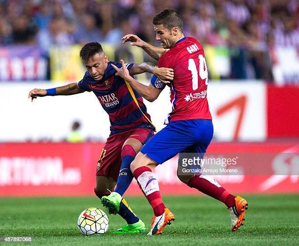 Neymar JR of FC Barcelona competes for the ball with Gabi Fernandez of Atletico de Madrid during the La Liga match between Club Atletico de Madrid...