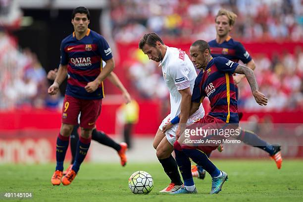Neymar JR of FC Barcelona competes for the ball with Grzegorz Krychowiak of Sevilla FC during the La Liga match between Sevilla FC and FC Barcelona...