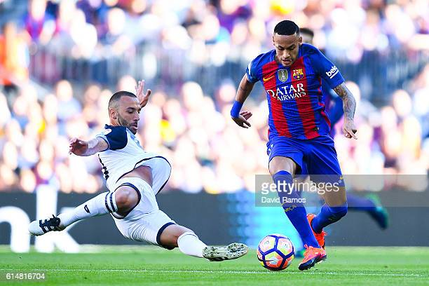 Neymar Jr of FC Barcelona competes for the ball with Guilherme dos Santos of RC Deportivo La Coruna during the La Liga match between FC Barcelona and...