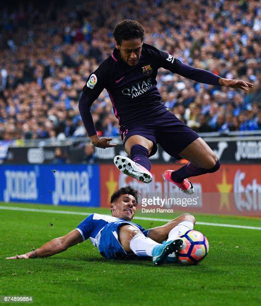 Neymar Jr of FC Barcelona competes for the ball with Hernan Perez of RCD Espanyol during the La Liga match between RCD Espanyol and FC Barcelona at...