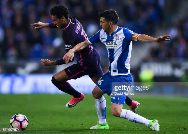Neymar Jr of FC Barcelona competes for the ball with Javi Lopez of RCD Espanyol during the La Liga match between RCD Espanyol and FC Barcelona at the...
