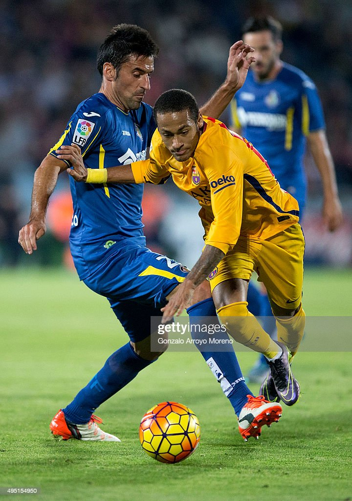 Neymar JR. (R) of FC Barcelona competes for the ball with Juan Antonio Rodriguez (L) of Getafe CF during the La Liga match between Getafe CF and FC Barcelona at Coliseum Alfonso Perez on October 31, 2015 in Getafe, Spain.