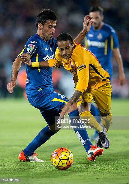Neymar JR of FC Barcelona competes for the ball with Juan Antonio Rodriguez of Getafe CF during the La Liga match between Getafe CF and FC Barcelona...