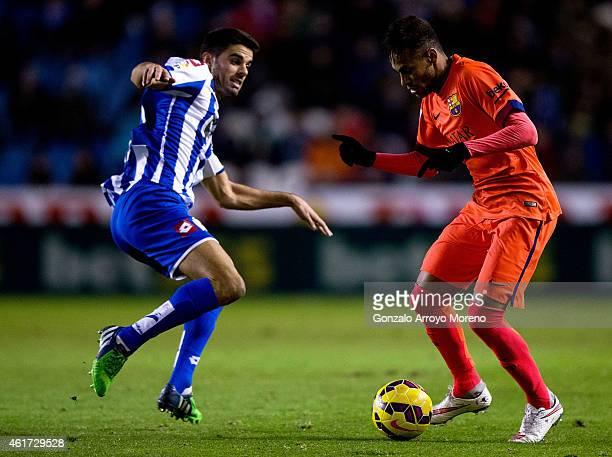 Neymar JR of FC Barcelona competes for the ball with Juanfran Moreno of RC Deportivo La Coruna during the La Liga match between RC Deportivo La...