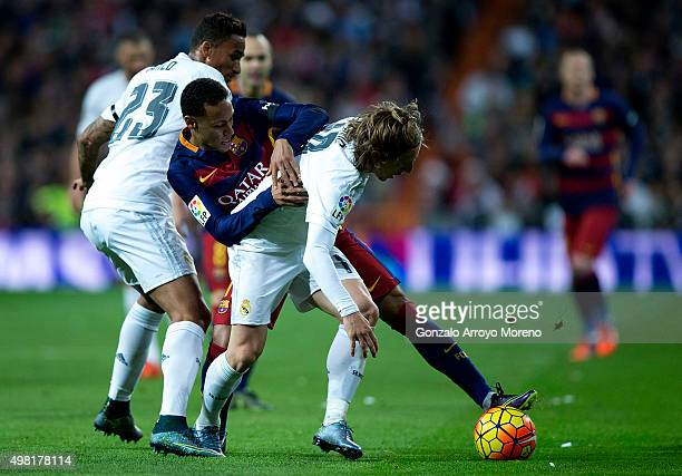 Neymar JR of FC Barcelona competes for the ball with Luka Modric of Real Madrid CF during the La Liga match between Real Madrid CF and FC Barcelona...