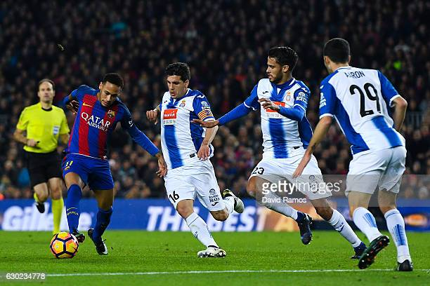 Neymar Jr of FC Barcelona competes for the ball with RCD Espanyol players during the La Liga match between FC Barcelona and RCD Espanyol at the Camp...