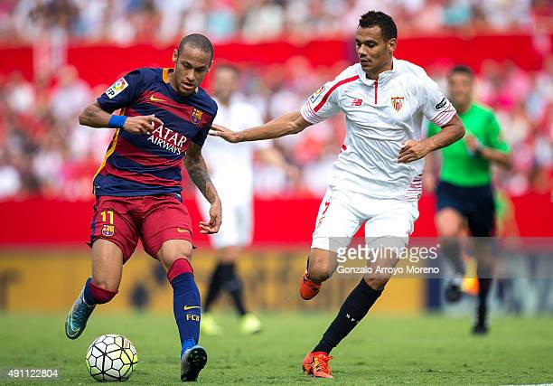 Neymar JR of FC Barcelona competes for the ball with Timothee Kolodziejczak of Sevilla FC during the La Liga match between Sevilla FC and FC...