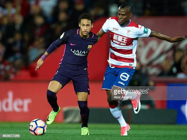 Neymar Jr of FC Barcelona competes for the ball with Uche Henry Agbo of Granada CF during the La Liga match between Granada CF v FC Barcelona at...