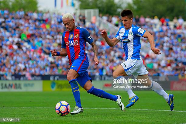 Neymar JR of FC Barcelona competes for the ball with Unai Bustinza of Deportivo Leganes during the La Liga match between Deportivo Leganes and FC...