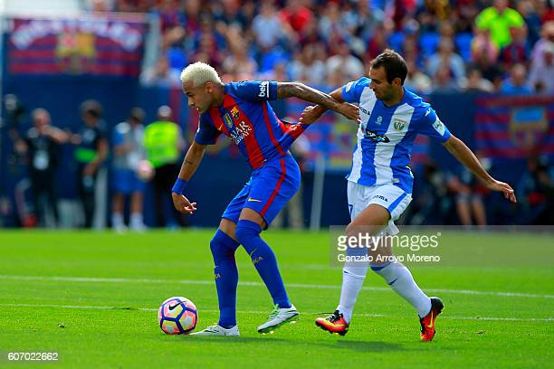 Neymar JR of FC Barcelona competes for the ball with Victor Diaz of Deportivo Leganes during the La Liga match between Deportivo Leganes and FC...