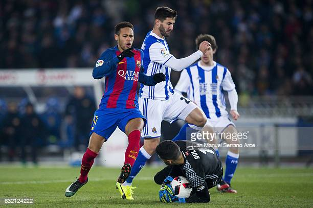 Neymar Jr of FC Barcelona duels for the ball with Raul Rodriguez Navas and Geronimo Rulli of Real Sociedad during the Copa del Rey Quarter Final...