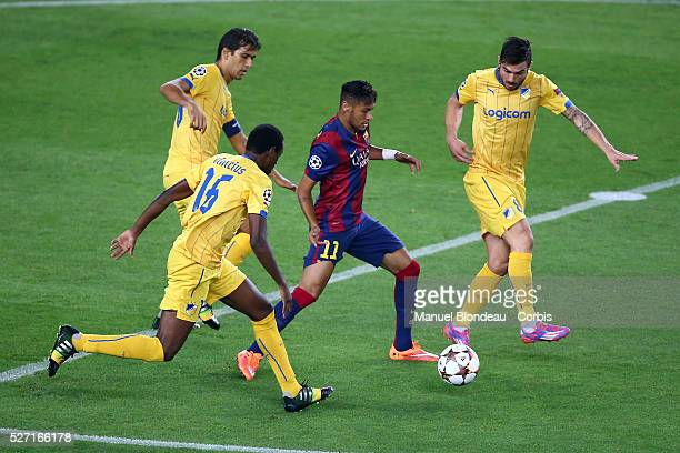 Neymar Jr of FC Barcelona duels for the ball with Vinicius and Tiago Gomes of Apoel FC during the UEFA Champions League Group F football match...