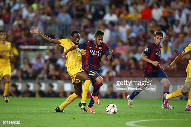 Neymar Jr of FC Barcelona duels for the ball with Vinicius Apoel FC during the UEFA Champions League Group F football match between FC Barcelona and...
