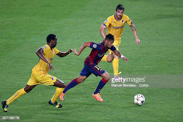Neymar Jr of FC Barcelona evades Vinicius of Apoel FC during the UEFA Champions League Group F football match between FC Barcelona and Apoel FC at...