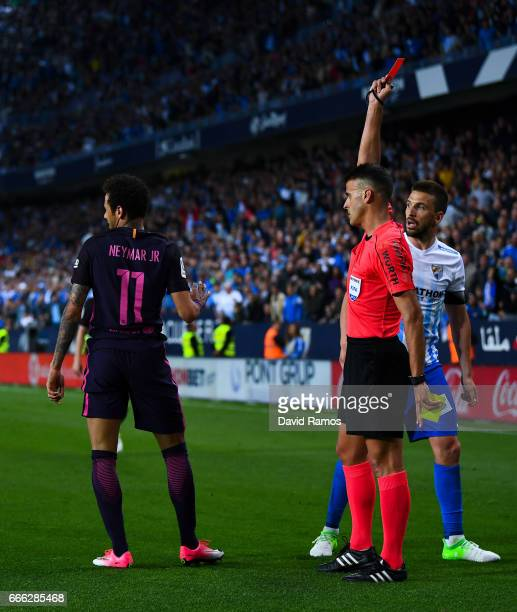 Neymar Jr of FC Barcelona is shown a red card during the La Liga match between Malaga CF and FC Barcelona at La Rosaleda stadium on April 8 2017 in...