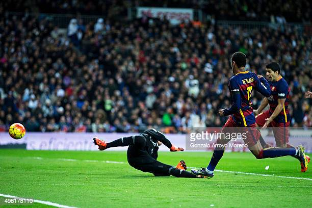 Neymar JR of FC Barcelona scores their second goal during the La Liga match between Real Madrid CF and FC Barcelona at Estadio Santiago Bernabeu on...