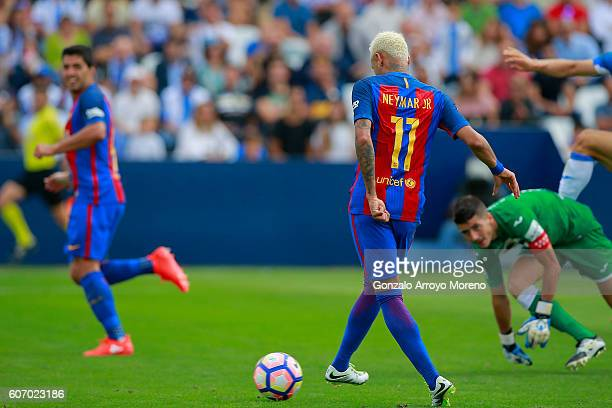 Neymar JR of FC Barcelona scores their third goal during the La Liga match between Deportivo Leganes and FC Barcelona at Estadio Municipal de...