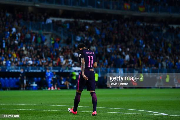 Neymar Jr of FC Barcelona walk out the pitch after being shown a red card during the La Liga match between Malaga CF and FC Barcelona at La Rosaleda...