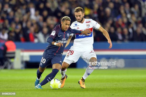 Neymar Jr of Paris SaintGermain and Lucas Tousart of Olympique Lyonnais fight for the ball during the Ligue 1 match between Paris Saint Germain and...