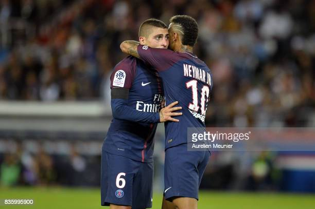 Neymar Jr of Paris SaintGermain calms down Marco Verrati after he got a red card during the Ligue 1 match between Paris SaintGermain and Toulouse at...