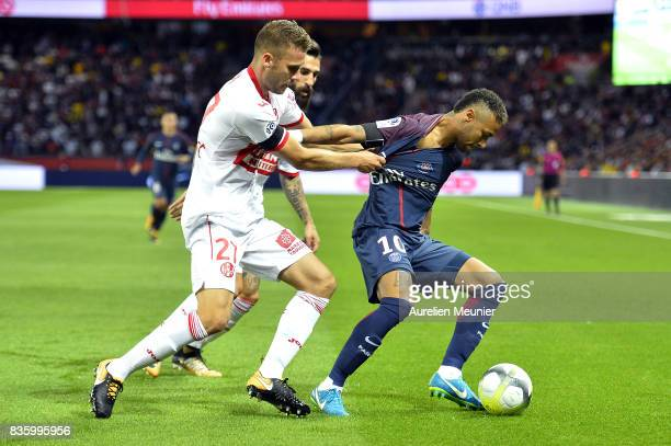 Neymar Jr of Paris SaintGermain fights for the ball during the Ligue 1 match between Paris SaintGermain and Toulouse at Parc des Princes on August 20...