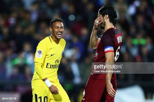 Neymar Jr of Paris SaintGermain Football Club or PSG has a laugh with Milan Bisevac of Metz FC during the Ligue 1 match between Metz and Paris Saint...