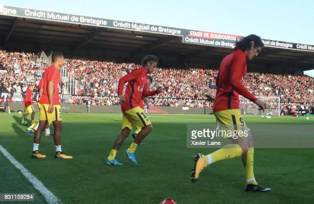 Neymar Jr of Paris SaintGermain in action with Edinson Cavani and Marquinhos during the warm up of the French Ligue 1 match between EA Guingamp and...