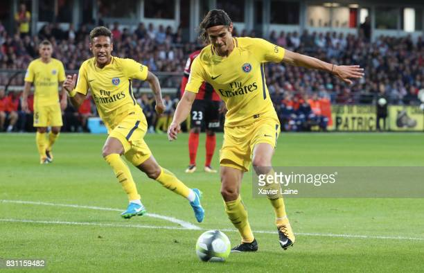 Neymar Jr of Paris SaintGermain in action with Edinson Cavani during the French Ligue 1 match between EA Guingamp and Paris Saint Germain at Stade du...