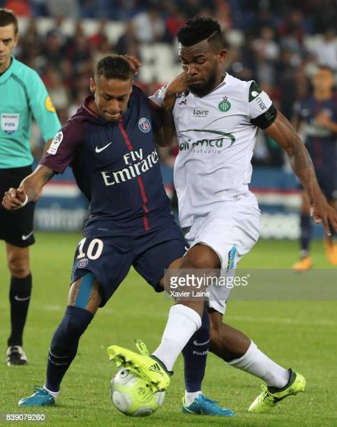 Neymar Jr of Paris SaintGermain in action with Habib Maiga of AS Saint Etienne during the French Ligue 1 match between Paris Saint Germain and AS...