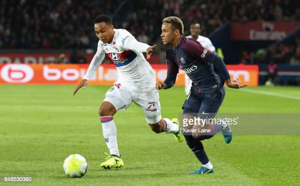 Neymar Jr of Paris SaintGermain in action with Kenny Tete of Olympique Lyonnais during the French Ligue 1 match between Paris Saint Germain and...