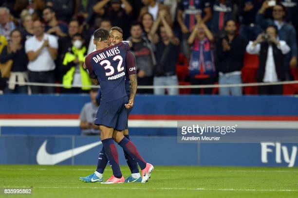 Neymar Jr of Paris SaintGermain is congratulated by Dani Alves after scoring during the Ligue 1 match between Paris SaintGermain and Toulouse at Parc...