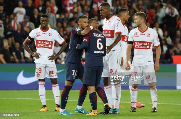 Neymar Jr of Paris SaintGermain react with Marco Verratti after his red card during the French Ligue 1 match between Paris Saint Germain and Toulouse...