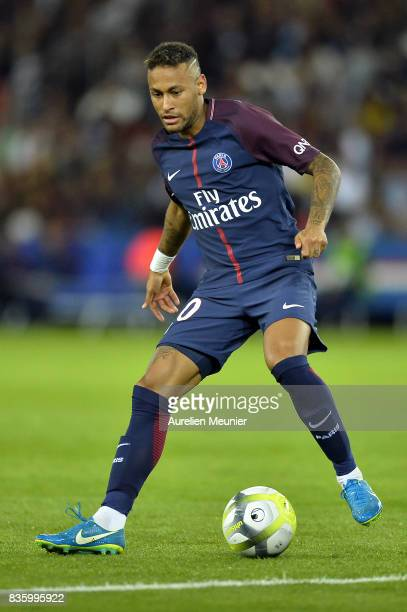Neymar Jr of Paris SaintGermain runs with the ball during the Ligue 1 match between Paris SaintGermain and Toulouse at Parc des Princes on August 20...