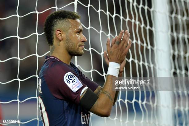 Neymar Jr of Paris SaintGermain salutes the fans after the Ligue 1 match between Paris SaintGermain and Toulouse at Parc des Princes on August 20...