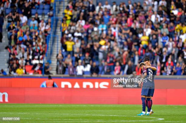 Neymar Jr of Paris SaintGermain talks with teammate Yuri Berchiche during the Ligue 1 match between Paris Saint Germain and FC Girondins de Bordeaux...