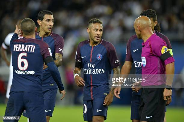 Neymar Jr of Paris SaintGermain talks with the referee after Marco Verrati got a red card during the Ligue 1 match between Paris SaintGermain and...