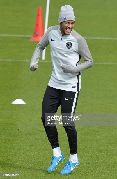 Neymar Jr of Paris SaintGermain warms up before a Paris SaintGermain training session at Centre Ooredoo on September 11 2017 in SaintGermain en Laye...