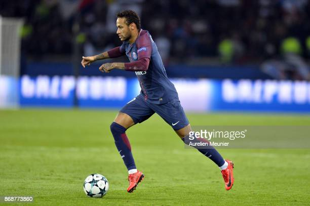Neymar Jr of ParisGermain runs with the ball during the UEFA Champions League group B match between Paris SaintGermain and RSC Anderlecht at Parc des...