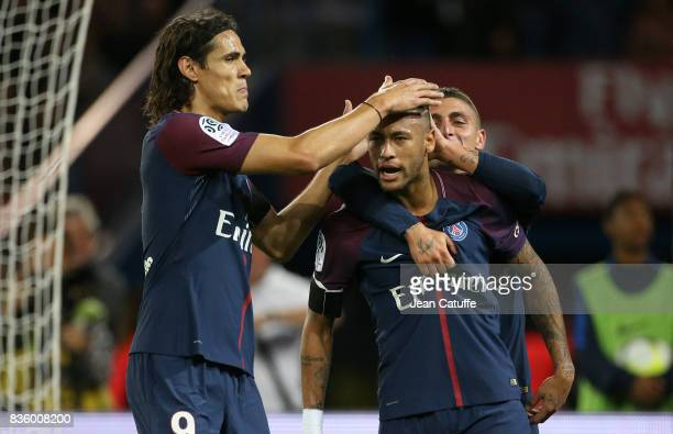 Neymar Jr of PSG celebrates his first goal with Edinson Cavani and Marco Verratti during the French Ligue 1 match between Paris Saint Germain and...