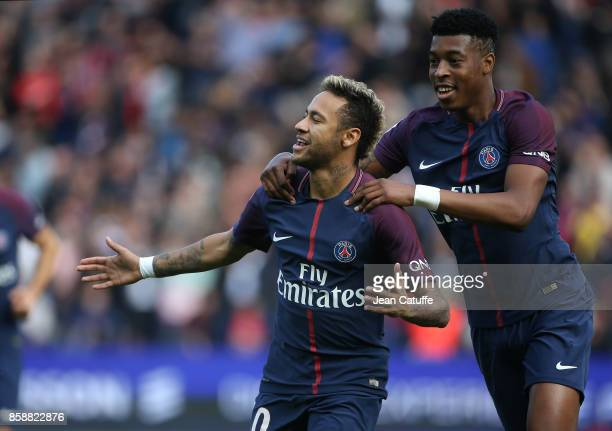 Neymar Jr of PSG celebrates his first goal with Presnel Kimpembe during the French Ligue 1 match between Paris SaintGermain and FC Girondins de...