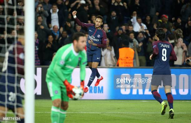 Neymar Jr of PSG celebrates his goal while goalkeeper of Anderlecht Frank Boeckx holds the ball during the UEFA Champions League group B match...